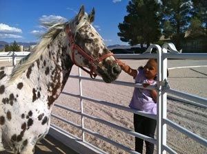 It was discovered that Poca had a special love for children, and she spent the summer at a local riding therapy center.